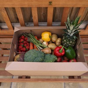 veg box as seen from above filled with produce
